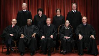 "WASHINGTON, DC - NOVEMBER 30: United States Supreme Court (Front L-R) Associate Justice Stephen Breyer, Associate Justice Clarence Thomas, Chief Justice John Roberts, Associate Justice Ruth Bader Ginsburg, Associate Justice Samuel Alito, Jr., (Back L-R) Associate Justice Neil Gorsuch, Associate Justice Sonia Sotomayor, Associate Justice Elena Kagan and Associate Justice Brett Kavanaugh pose for their official portrait at the in the East Conference Room at the Supreme Court building November 30, 2018 in Washington, DC. Earlier this month, Chief Justice Roberts publicly defended the independence and integrity of the federal judiciary against President Trump after he called a judge who had ruled against his administration's asylum policy ""an Obama judge."" ""We do not have Obama judges or Trump judges, Bush judges or Clinton judges,"" Roberts said in a statement. ""What we have is an extraordinary group of dedicated judges doing their level best to do equal right to those appearing before them. That independent judiciary is something we should all be thankful for."" (Photo by Chip Somodevilla/Getty Images)"