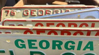 Brooklyn, NYC - April 28, 2018: A collection of vintage motor vehicle metal license plates from Georgia USA at an outdoor flea market.