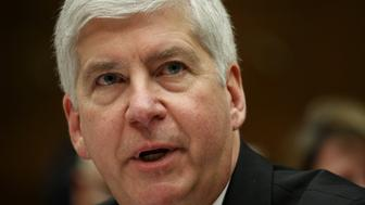 "Michigan Governor Rick Snyder testifies before a House Oversight and government Reform hearing  on ""Examining Federal Administration of the Safe Drinking Water Act in Flint, Michigan, Part III"" on Capitol Hill in Washington March 17, 2016. REUTERS/Kevin Lamarque"
