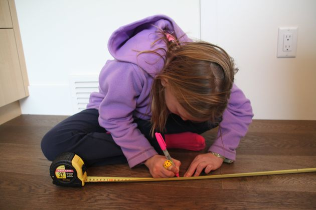 Nora Keegan, 10, marks the height of air dryers on her measuring