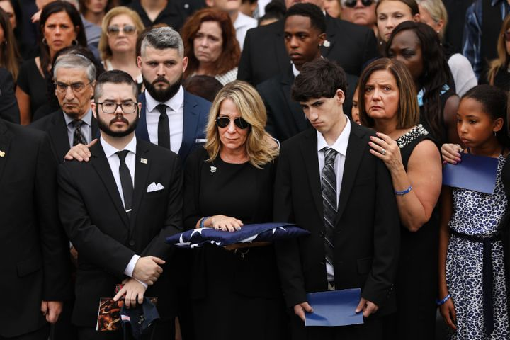 Lainie Alvarez stands after the funeral for former NYPD detective Luis Alvarez, a former New York City police detective who w