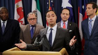 U.S. Rep. Joaquin Castro, D-Texas, center, stands with state senators as he addresses a GOP-backed resolution in the Texas Legislature supporting President Donald Trump's declaration of an emergency on the U.S.-Mexico border has reignited an immigration debate in the Capitol, Wednesday, April 17, 2019, in Austin, Texas. (AP Photo/Eric Gay)