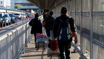 "People walk and drive across the International Bridge on the US/Mexico border in Laredo, Texas, on January 13, 2019. - Thousands of people cross back and forth every day, in cars or on foot, between Laredo, Texas and its sister city Nuevo Laredo in the Mexican state of Tamaulipas. The two cities have a ""strong connection without a doubt,"" Laredo mayor Pete Saenz, an independent, told AFP. ""We are connected economic-wise, culture-wise, socially as well."" But Laredo also bears the marks of the heated debate over immigration that has roiled the country since the 2016 election of Donald Trump. (Photo by SUZANNE CORDEIRO / AFP)        (Photo credit should read SUZANNE CORDEIRO/AFP/Getty Images)"