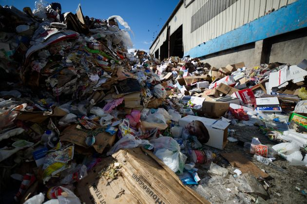 Unsorted rubbish is piled up on the yard outside the Materials Recovery Facility, in South Philadelphia...