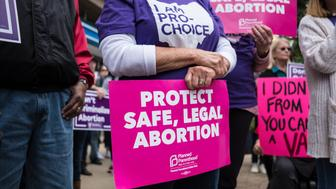 DAYTON, OHIO, UNITED STATES - 2019/05/19: An activist seen holding a placard that says protect safe, legal abortion during the protest. Abortion rights activists took part in stop the bans rally nationwide after multiple states pass fetal heartbeat bills. (Photo by Megan Jelinger/SOPA Images/LightRocket via Getty Images)