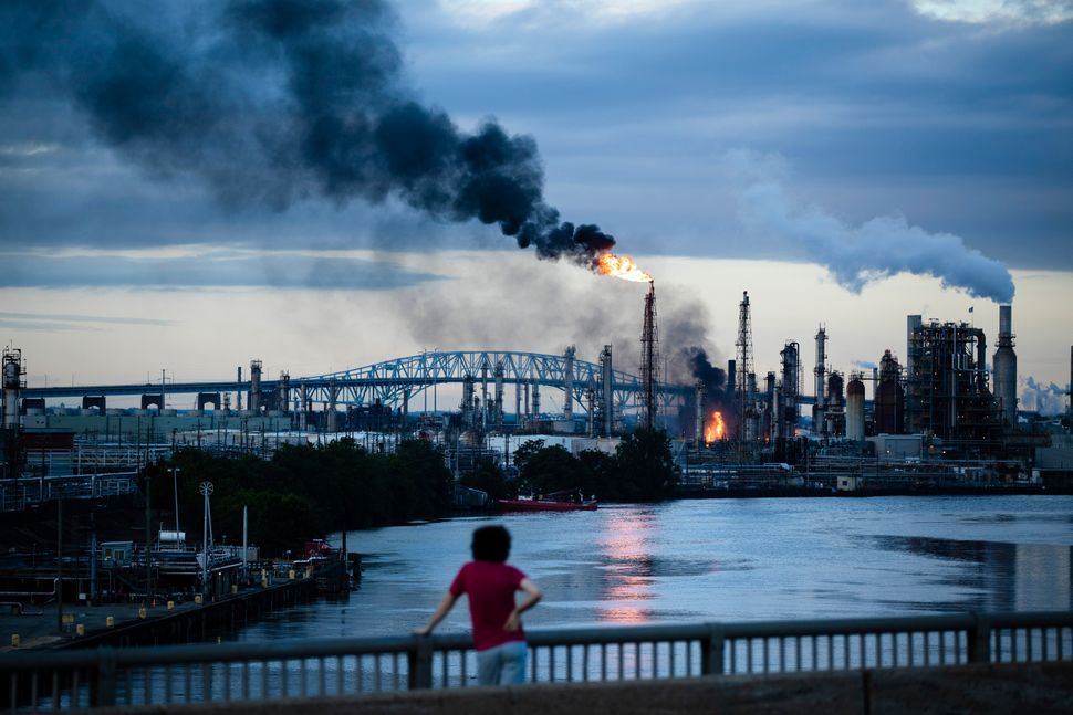 A South Philly resident watches as the Philadelphia Energy Solutions refinery goes up in flames on June 21.