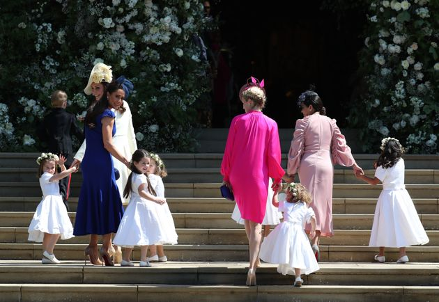 Jessica Mulroney, in blue on the left, leads her daughter Ivy at Meghan Markle and Prince Harry's wedding...
