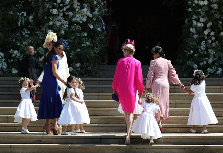 Jessica Mulroney, in blue on the left, leads her daughter Ivy at Meghan Markle and Prince Harry's wedding at Windsor Castle on May 19, 2018.