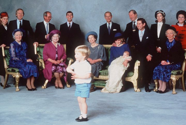 Prince William steals the show at Prince Harry's christeningat Windsor Castle on December 21, 1984, with relatives and godparents in the background.