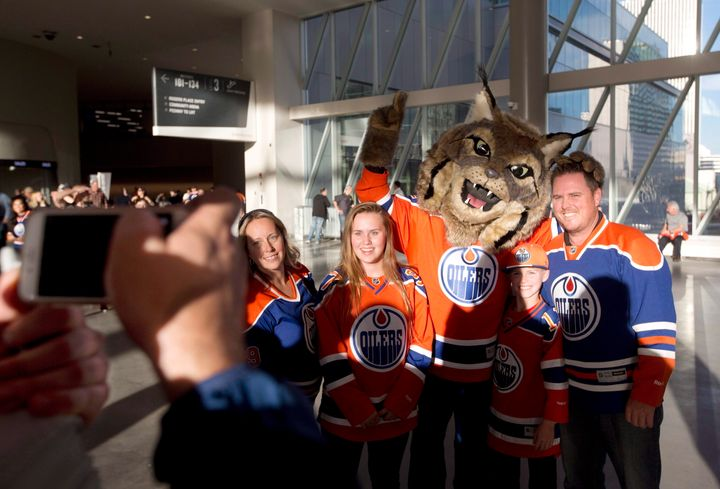 Hunter, the Edmonton Oilers' mascot, poses with fans.