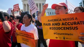 Demonstrators gather at the Supreme Court as the justices finish the term with key decisions on gerrymandering and a census case involving an attempt by the Trump administration to ask everyone about their citizenship status in the 2020 census, on Capitol Hill in Washington, Thursday, June 27, 2019. (AP Photo/J. Scott Applewhite)