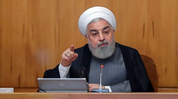 "In this photo released by the office of the Iranian Presidency, President Hassan Rouhani speaks in a cabinet meeting in Tehran, Iran, Wednesday, July 3, 2019. Rouhani warned European partners in its faltering nuclear deal on Wednesday that Tehran will increase its enrichment of uranium to ""any amount that we want"" beginning on Sunday, putting pressure on them to offer a way around intense U.S. sanctions targeting the country. (Iranian Presidency Office via AP)"