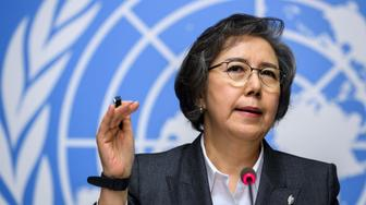 """United Nations (UN) Special Rapporteur to Myanmar Yanghee Lee gestures as she speaks at a press conference after addressing her report before the Human Rights Council in Geneva on March 12, 2018.  A top UN rights expert warned that the crackdown on Myanmar's Rohingya minority bears """"the hallmarks of genocide"""" and insisted the government should be held accountable. Nearly 700,000 Rohingya Muslims have fled northern Rakhine state to Bangladesh since Myanmar launched a brutal crackdown on insurgents six months ago amid accounts of arson, murder and rape at the hands of soldiers and vigilante mobs in the mainly Buddhist country.  / AFP PHOTO / Fabrice COFFRINI        (Photo credit should read FABRICE COFFRINI/AFP/Getty Images)"""