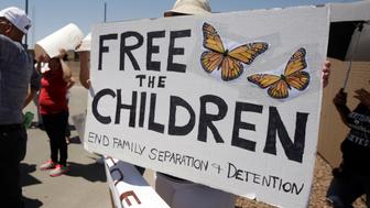 Activists hold a protest against the treatment and conditions of children in immigration detention outside U.S. Customs and Border Protection's Border Patrol station facilities in Clint, Texas, U.S., June 27, 2019. REUTERS/Jose Luis Gonzalez Gonzalez