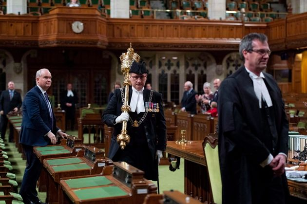 Patrick McDonell, seen here when he was the deputy sergeant-at-arms, carries the mace out of the...