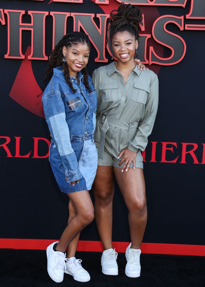 """Halle Bailey, L, looking every bit like a damn Disney Princess, arrives at the """"Stranger Things""""Season 3 Premiere in Santa Monica with her sister, Chloe."""