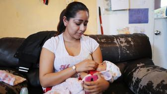 EL PASO, TEXAS - MAY 15: A Central American migrant mother cares for her baby in an Annunciation House facility for migrants on May 15, 2019 in El Paso, Texas. Approximately 1,000 migrants per day are being released by authorities in the El Paso sector of the U.S.-Mexico border. President Trump is expected to present a new immigration plan in a White House Rose Garden speech tomorrow.  (Photo by Mario Tama/Getty Images)