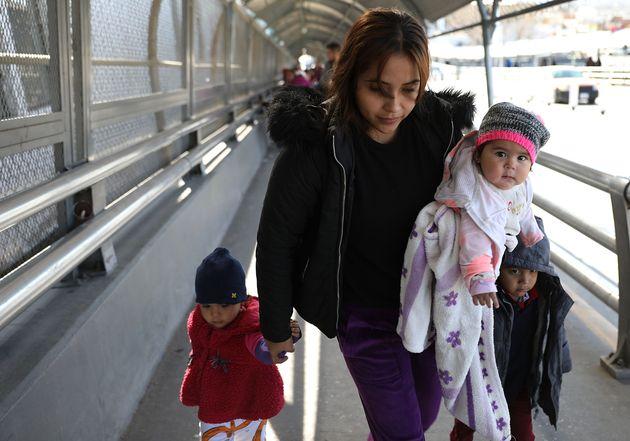 Daniela Serrano and her baby, Maria de Jesus Cabrera, from Michoacan, Mexico cross the Paso Del Norte...