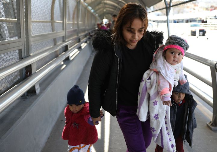 Daniela Serrano and her baby, Maria de Jesus Cabrera, from Michoacan, Mexico cross the Paso Del Norte Port of Entry bridge to