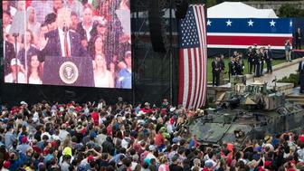 "WASHINGTON, DC - JULY 04: A screen projects a video feed of President Donald Trump as he delivers remarks during the ""Salute to America"" ceremony in front of the Lincoln Memorial, on July 4, 2019 in Washington, DC. The presentation featured armored vehicles on display, a flyover by Air Force One, and several flyovers by other military aircraft. (Photo by Sarah Silbiger/Getty Images)"