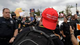 A member of the Proud Boys group confront anti-President Donald Trump protestors during a rally Tuesday, June 18, 2019, in Orlando, Fla. (AP Photo/Chris O'Meara)