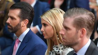 (L-R) Donald Trump Junior, Ivanka Trump and Eric Trump listen to their father, US President Donald Trump give a joint press conference at the Foreign and Commonwealth office in London on June 4, 2019, on the second day of their three-day State Visit to the UK. - US President Donald Trump turns from pomp and ceremony to politics and business on Tuesday as he meets Prime Minister Theresa May on the second day of a state visit expected to be accompanied by mass protests. (Photo by MANDEL NGAN / AFP)        (Photo credit should read MANDEL NGAN/AFP/Getty Images)