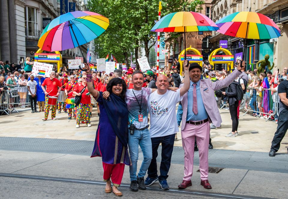 Andrew Moffat, pioneer of the inclusive No Outsiders programme, walks arm in arm with LGBTQ Muslim campaigners...