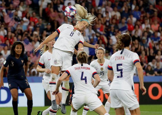 Julie Ertz, a midfielder on the U.S. women's national team, heads the ball in the match against France....