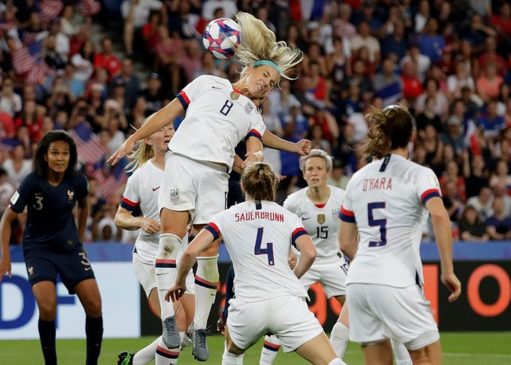 Julie Ertz, a midfielder on the U.S. women's national team, heads the ball in the match against France. The U.S. won that game 2-1.