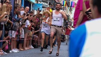 Participants compete in the traditional street high heel race as part of the LGTBIQ  Pride Week 2019 in Madrid, Spain, 04 July 2019The race takes place in the Chueca district, popular in the LGBT scene, in the Spain (Photo by Oscar Gonzalez/NurPhoto via Getty Images)