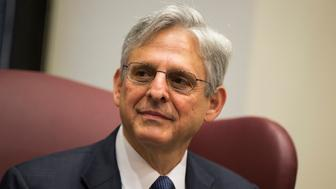 "FILE- In this April 28, 2016, file photo, Judge Merrick Garland, President Barack Obama's choice to replace the late Justice Antonin Scalia on the Supreme Court meets with Sen. Gary Peters, D-Mich., on Capitol Hill in Washington. Sen. Orrin Hatch of Utah was scheduled to meet Thursday with Supreme Court nominee Merrick Garland, but a guest editorial he wrote for the Deseret News mistakenly posted early shows he had already made up his mind. In a column that briefly appeared Thursday morning on the newspaper's website, Hatch wrote that his meeting with Garland didn't change his ""conviction"" that the Senate should wait until after the presidential election to consider Supreme Court nominees. The column has since been taken down. (AP Photo/Evan Vucci, File)"
