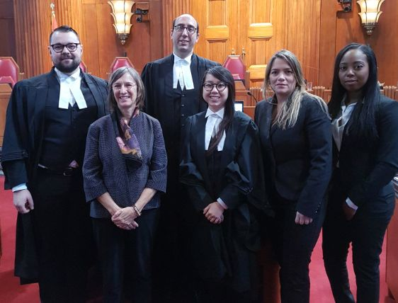 Linda Vannucci, second from left, poses with some of her staff from the Workers' Health & Safety Legal Clinic at the Supreme Court of Canada in December 2018.