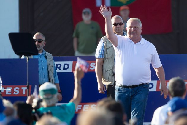 Ontario Premier Doug Ford waves to the crowd after delivering remarks during Ford Fest...