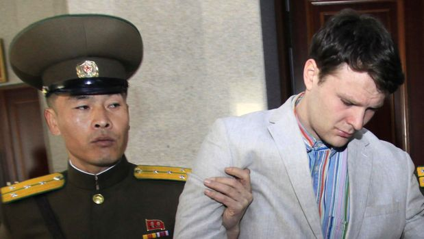 FILE - In this March 16, 2016, file photo, American student Otto Warmbier, center, is escorted at the Supreme Court in Pyongyang, North Korea. President Donald Trump had previously condemned the cruelty of North Korea's government, but after his historic summit on Tuesday with North Korean leader Kim Jong Un, Trump seemed to play down the severity of human rights violations in North Korea. (AP Photo/Jon Chol Jin, File)
