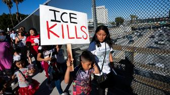 LOS ANGELES, CALIFORNIA, UNITED STATES - 2019/07/01: A child holds a placard that says ICE (Immigration and Customs Enforcement) Kills during a symbolic funeral procession in honour of migrants who died attempting to cross the border into the U.S. or while in the custody of Customs and Border Protection. Organizers called the event Homeland Security Kills Rally. (Photo by Ronen Tivony / SOPA Images/SOPA Images/LightRocket via Getty Images)