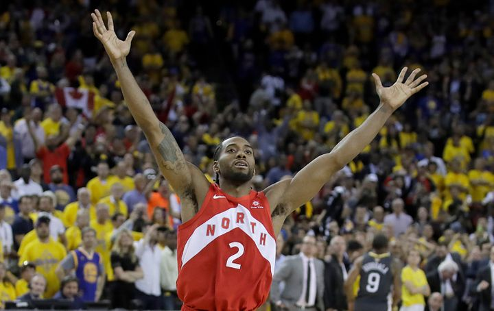 Toronto Raptors forward Kawhi Leonard celebrates after the Raptors defeated the Golden State Warriors in Game 6 of basketball