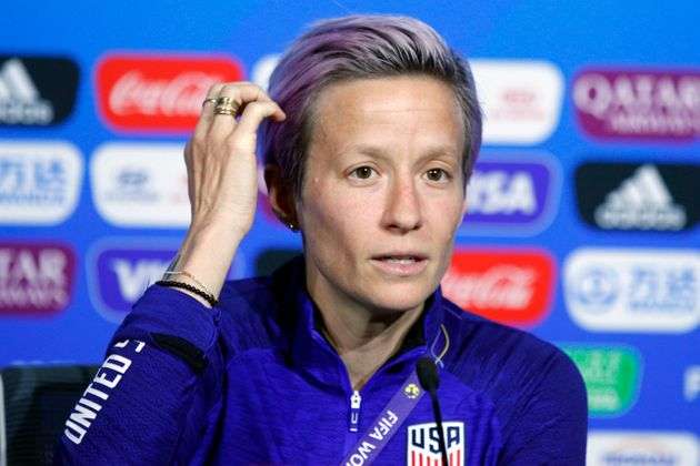 Megan Rapinoe speaks to reporters at a press conference near Lyon, France, on July
