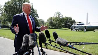 President Donald Trump talks to reporters on the South Lawn of the White House before departing for his Bedminster, N.J. golf club, Friday, July 5, 2019, in Washington. (AP Photo/Evan Vucci)
