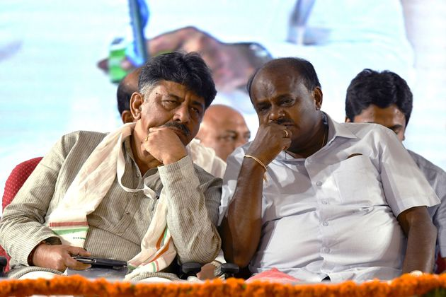 Karnataka CM H.D.Kumarswamy and senior Congress leader D.Shivkumar in a file