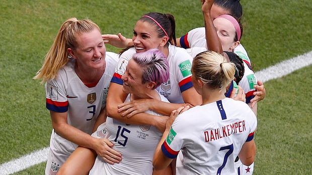 United States' Megan Rapinoe, second from left, celebrates with teammates after scoring her side's first goal by penalty during the Women's World Cup final soccer match between US and The Netherlands at the Stade de Lyon in Decines, outside Lyon, France, Sunday, July 7, 2019. (AP Photo/Francois Mori)