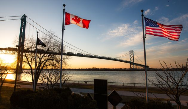 The Ambassador Bridge, linking Detroit, Mich., Windsor, Ont., with Canadian and U.S. flags in the