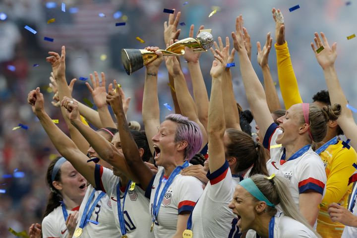 Rapinoe holds the trophy after winning the Women's World Cup final soccer match against the Netherlands.