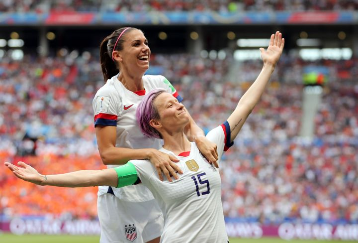 Megan Rapinoe (right) celebrates after scoring the opening goal from the penalty spot during the Women's World Cup final socc