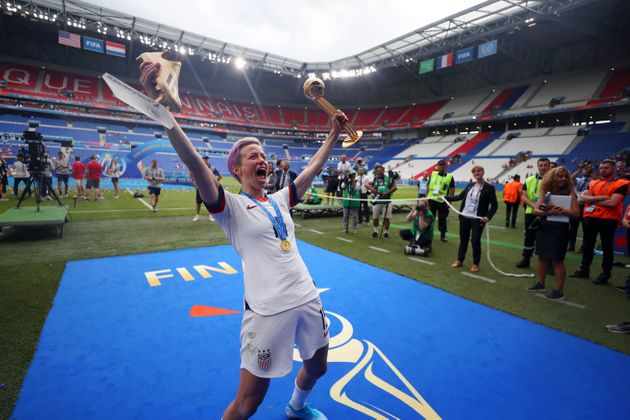 Rapinoe celebrates with her trophies as the best player and top scorer of World