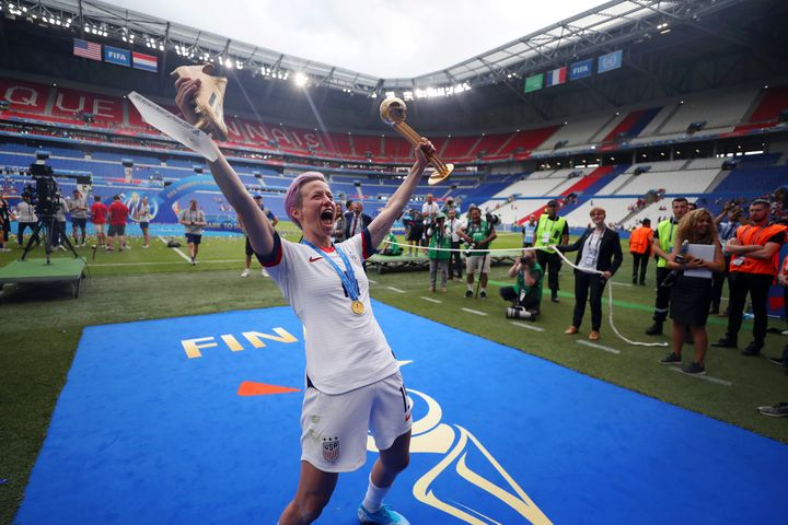 Rapinoe celebrates with her trophies as the best player and top scorer of World Cup.