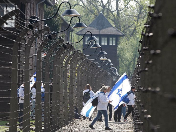 Participants in the Jewish event of Holocaust remembrance walk in the former Nazi World War II death camp of Auschwitz in Osw