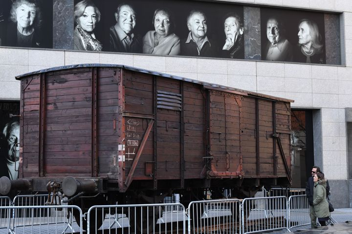 Portraits of Holocaust survivors are displayed in April 2019 at New York's Museum of Jewish Heritage, as a vintage German tra