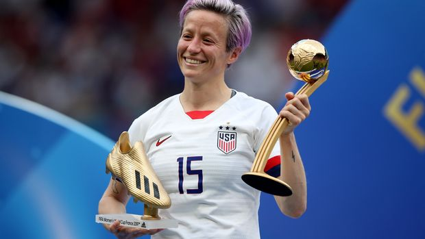 LYON, FRANCE - JULY 07: Megan Rapinoe of USA poses with her Golden boot and player of the tournament awards during the 2019 FIFA Women's World Cup France Final match between The United States of America and The Netherlands at Stade de Lyon on July 7, 2019 in Lyon, France. (Photo by Marc Atkins/Getty Images)