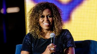NEW ORLEANS, LOUISIANA - JULY 06: Former First Lady Michelle Obama (L) is interviewed by Gayle King at the 25th Essence Music Festival at The Mercedes-Benz Superdome on July 06, 2019 in New Orleans, Louisiana. (Photo by Josh Brasted/FilmMagic)