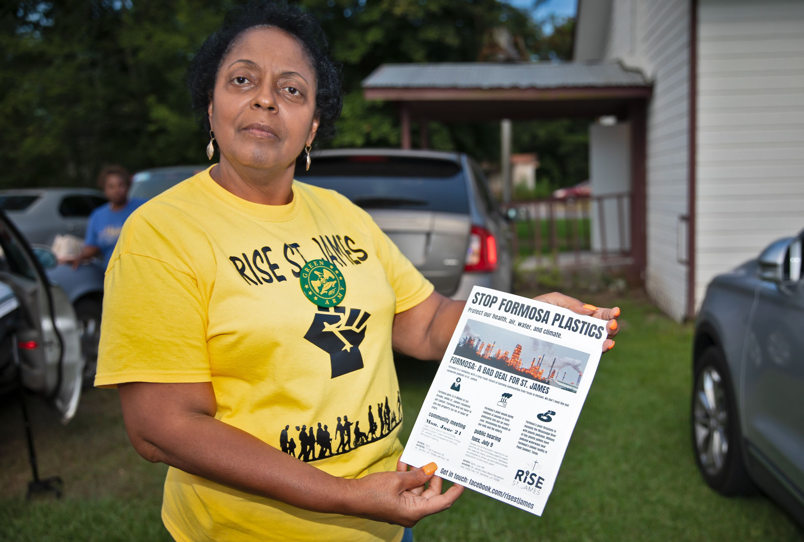 Sharon Lavinge founder of RISE St. James in front of the Mt. Triumph Baptist Church with a flyer about the proposed Formosa p